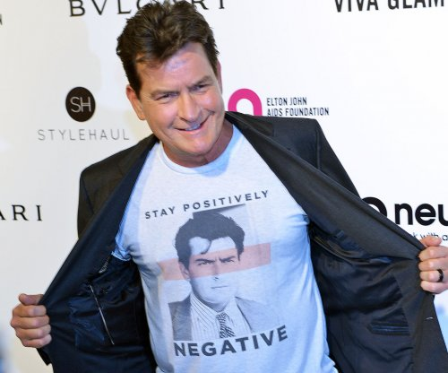 Charlie Sheen hints at sex with government minister's daughter, denies infecting partners