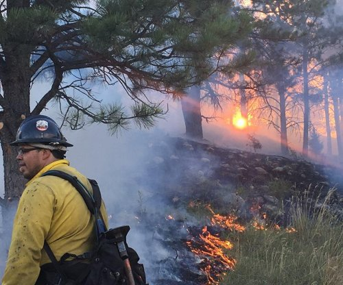 Rain slows South Dakota wildfire, cancels evacuations