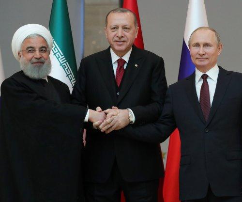 Russia, Turkey and Iran begin Ankara summit to discuss Syria