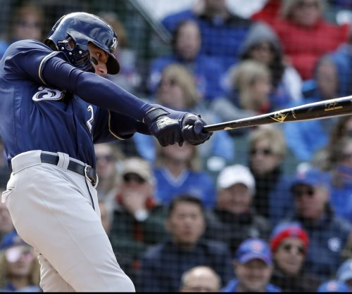 Brewers take aim at Reds in series finale