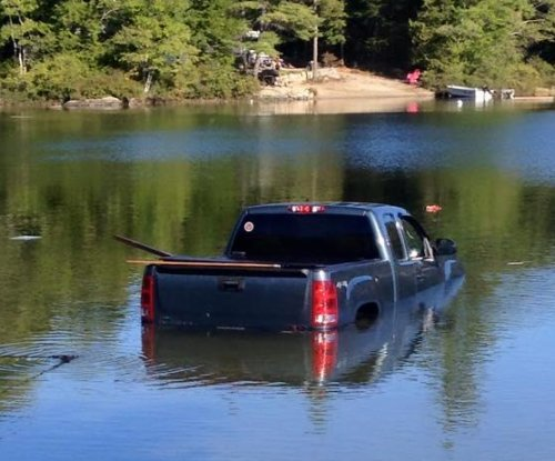 Police: Dog rescued after driving owner's pickup into lake