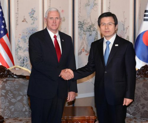 China stands by North Korea policy as Pence visits Seoul