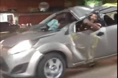 Brazilian man drives badly-damaged Ford with collapsed roof