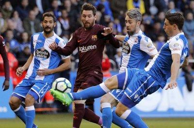 Messi scores three times in Barcelona's La Liga clincher
