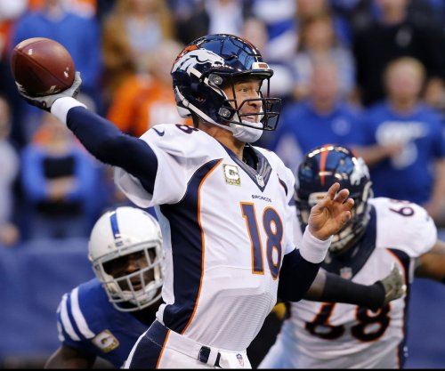 Peyton Manning misses records, but 13 INTs leads NFL