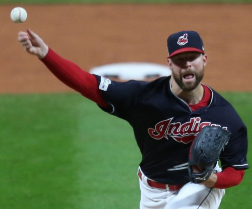 Indians' Kluber aims to show Sox's Lopez how it's done