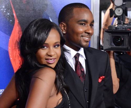 Bobbi Kristina Brown died of complications from drugs, immersion