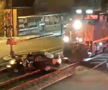Train clears stranded car from the railroad tracks in Virginia