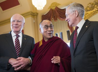 Dalai Lama gives the opening prayer in Senate