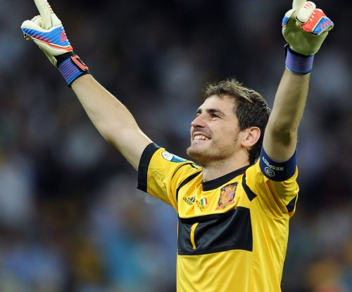 Iker Casillas: Spain's goalie won't retire until Italian keeper does