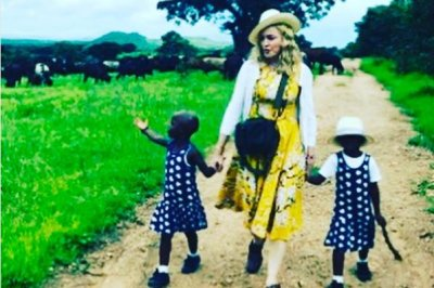 Madonna introduces her twin daughters: 'I am overjoyed'