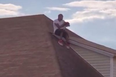 Stranger helps rescue dog from Rhode Island roof