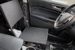 Driver pulled over for using folding lawn chair as car seat