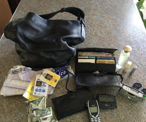 Purse stolen 14 years ago found in garbage can and returned to owner