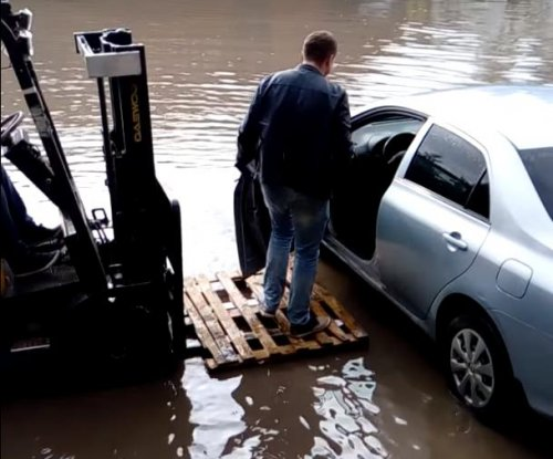 Forklift driver gives man a lift through flood