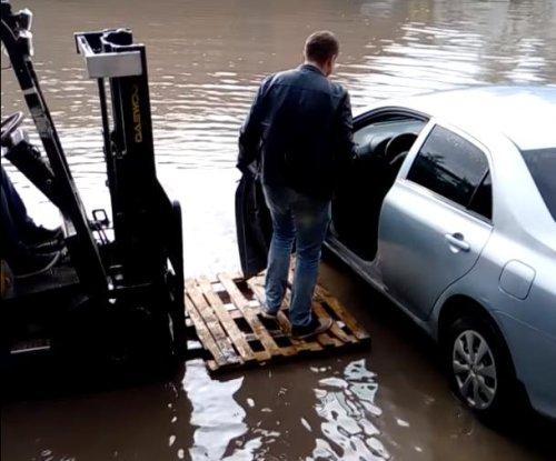 Forklift driver gives man a lift through flood