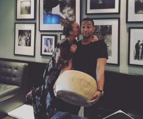 John Legend delivers Chrissy Teigen her 'lifetime dream for Christmas'