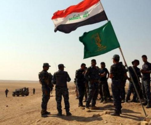 Nearly a dozen mass graves tied to Islamic State found in Iraq