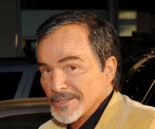Burt Reynolds says he isn't broke despite auction