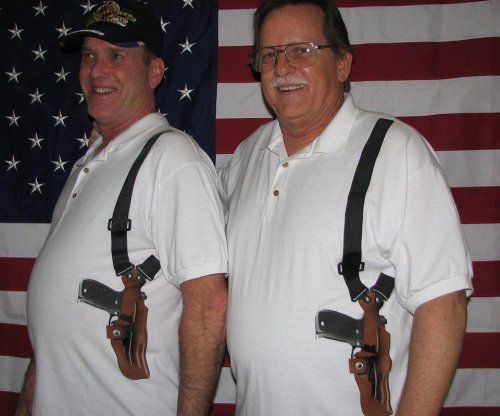 T-shirts feature realistic guns in shoulder-strap holsters