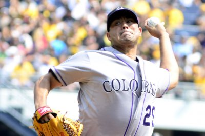 Tony Wolters contributes with bat to Colorado Rockies' 11-6 victory