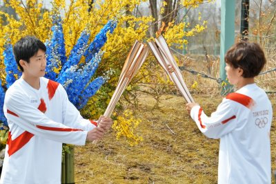 Tokyo Olympic torch relay begins 121-day journey across Japan