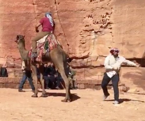 Watch: Detroit Lions' special teamer performs trick snap under a camel in Jordan