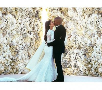 Annie Leibovitz's rep says she was 'never confirmed' to shoot Kimye's wedding