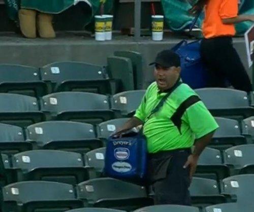 Foul ball strikes ballpark vendor in the rear end