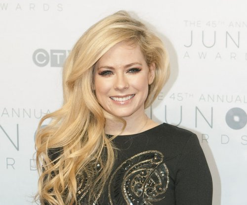 Avril Lavigne teases new album after 'long recovery' from illness