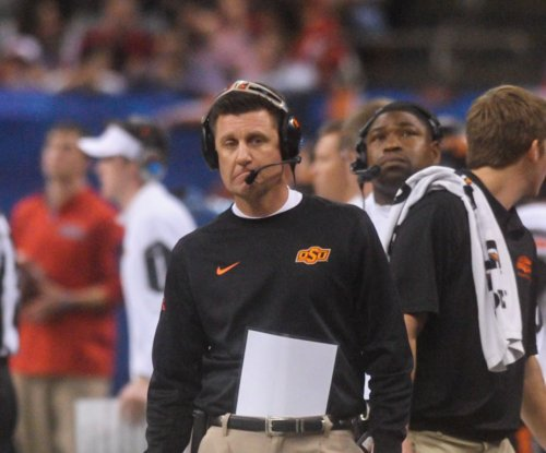 Oklahoma State football coach Mike Gundy explains how he would coach his son