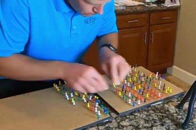, Watch: Idaho man moves 133 thumbtacks between boards in 1 minute, Forex-News, Forex-News