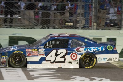Kyle Larson dominates in Homestead Xfinity win; Chris Buescher clinches series title