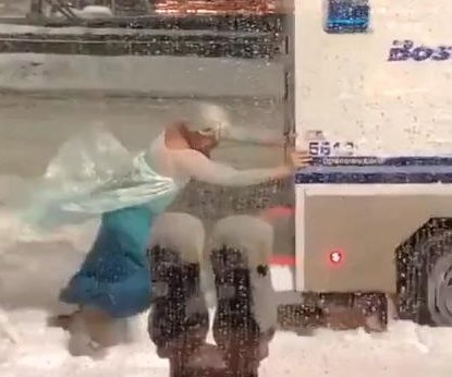 Man dressed as Elsa pushes Boston police wagon out of snowbank