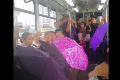 Watch:-Philippines-train-passengers-use-umbrellas-inside