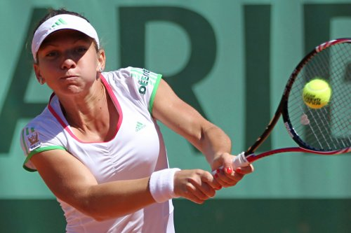 Halep opens WTA Tournament of Champions with win
