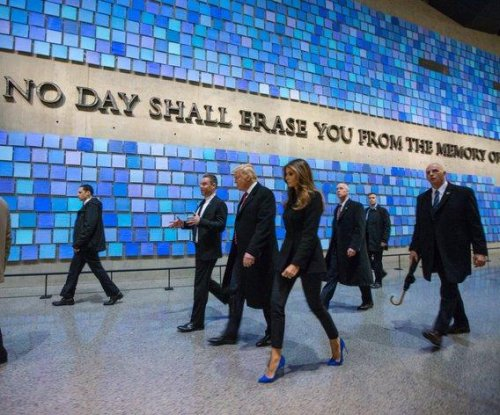 Donald Trump visits 9/11 memorial in veiled shot at Ted Cruz