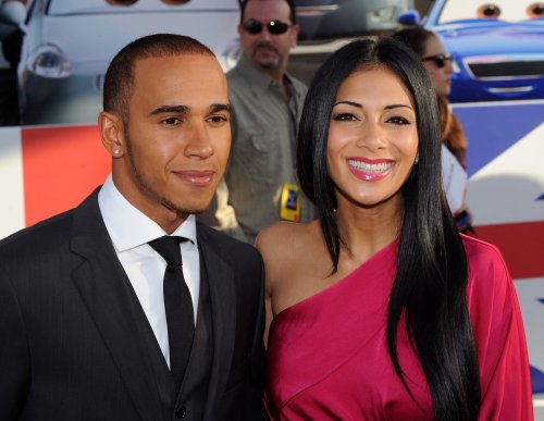 Nicole Scherzinger 'just friends' with Lewis Hamilton