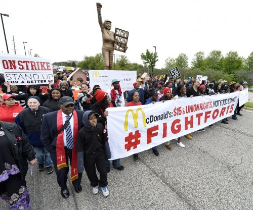 McDonald's headquarters shut as protesters demand $15 an hour