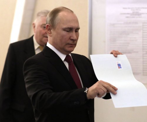 Russians head to polls to re-elect Putin for fourth term