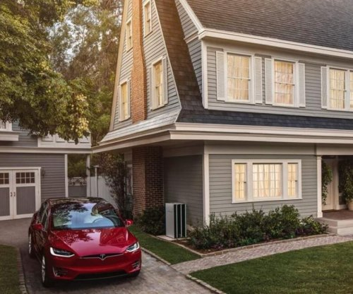 Tesla takes orders for solar roof tiles, reveals 'affordable' prices