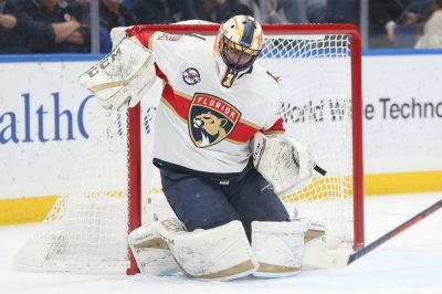 Florida Panthers goalie Roberto Luongo saves puck off referee