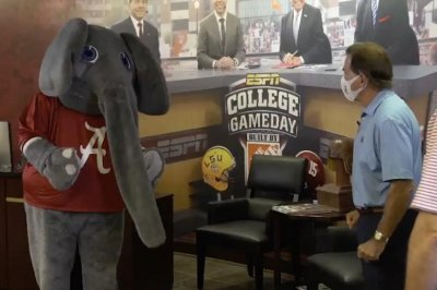 Alabama football coach Nick Saban scolds elephant mascot in COVID-19 PSA