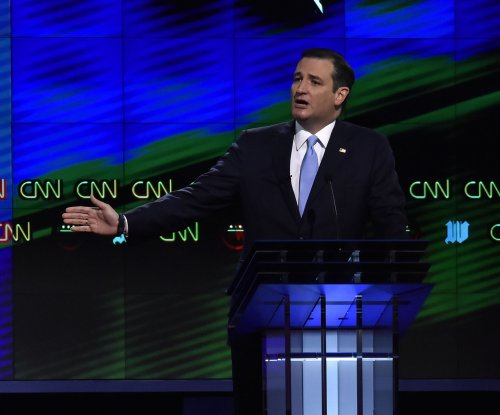 Ted Cruz calls Trump and Clinton 'flip side of the same coin'