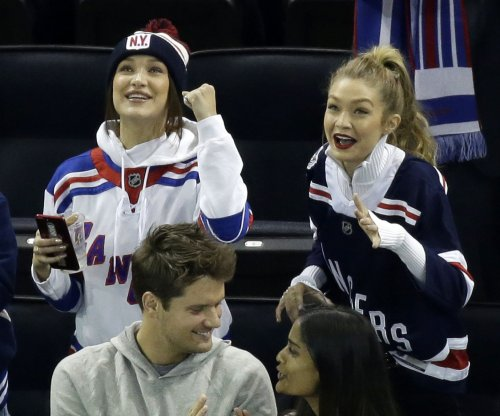 Gigi Hadid attends hockey game with sister Bella, Zayn Malik's mom
