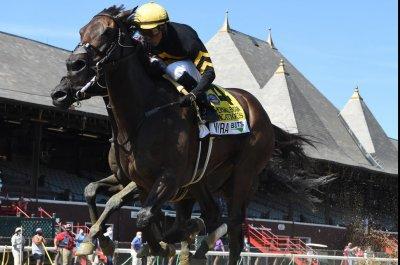 Baffert wins three big ones; upsets rule in weekend horse racing