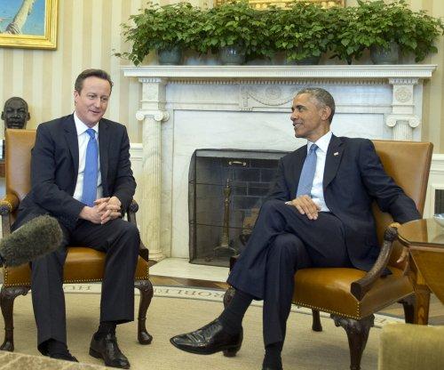Obama warns Congress of veto on Iran sanctions