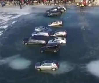 15 vehicles parked on ice fall through into Wisconsin lake