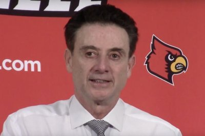 No. 11 Louisville stays in ACC title race with narrow win