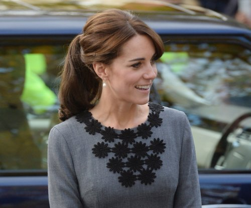 Kate Middleton stuns in gray dress and ponytail while visiting charity